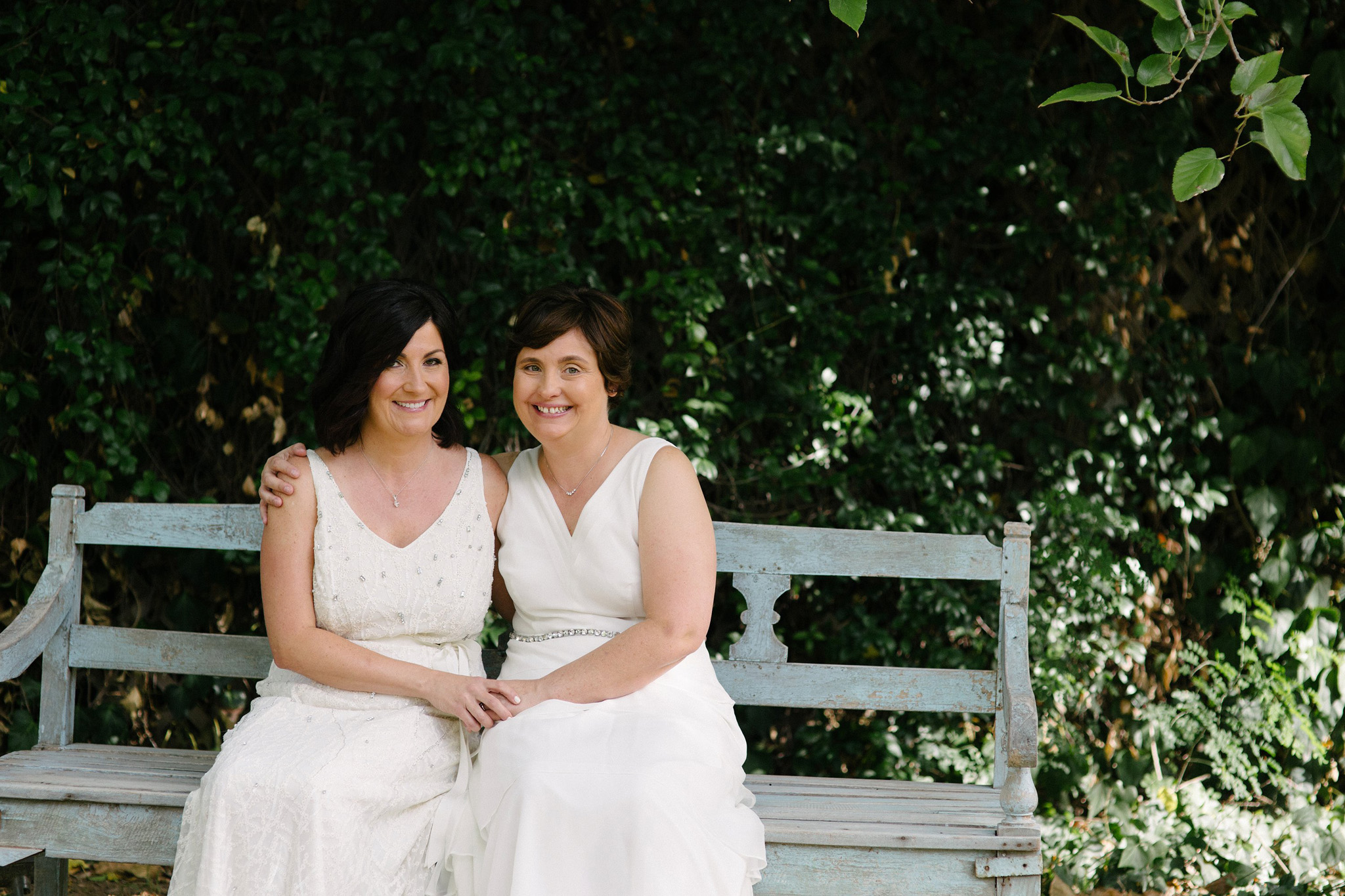 gay wedding two brides in white dresses at the Farm at South Mountain
