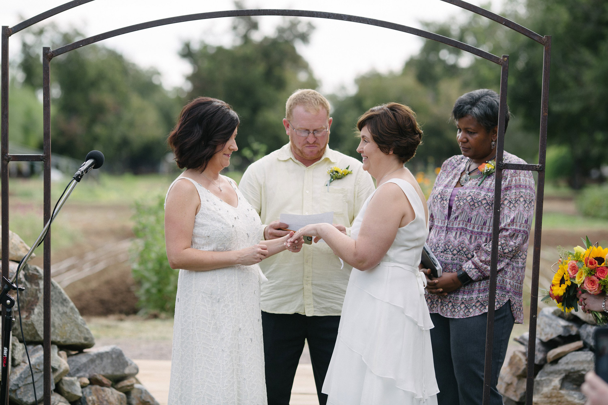 two brides in white dresses gay wedding ceremony Farm at South Mountain