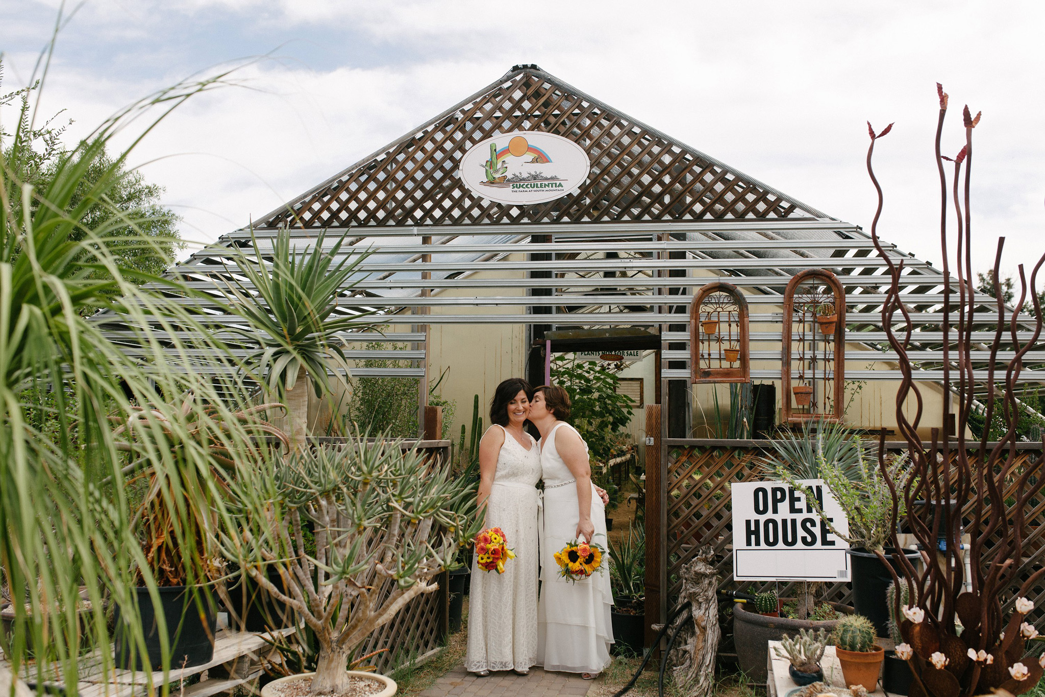 two brides by a greenhouse Farm at South Mountain Phoenix wedding photos