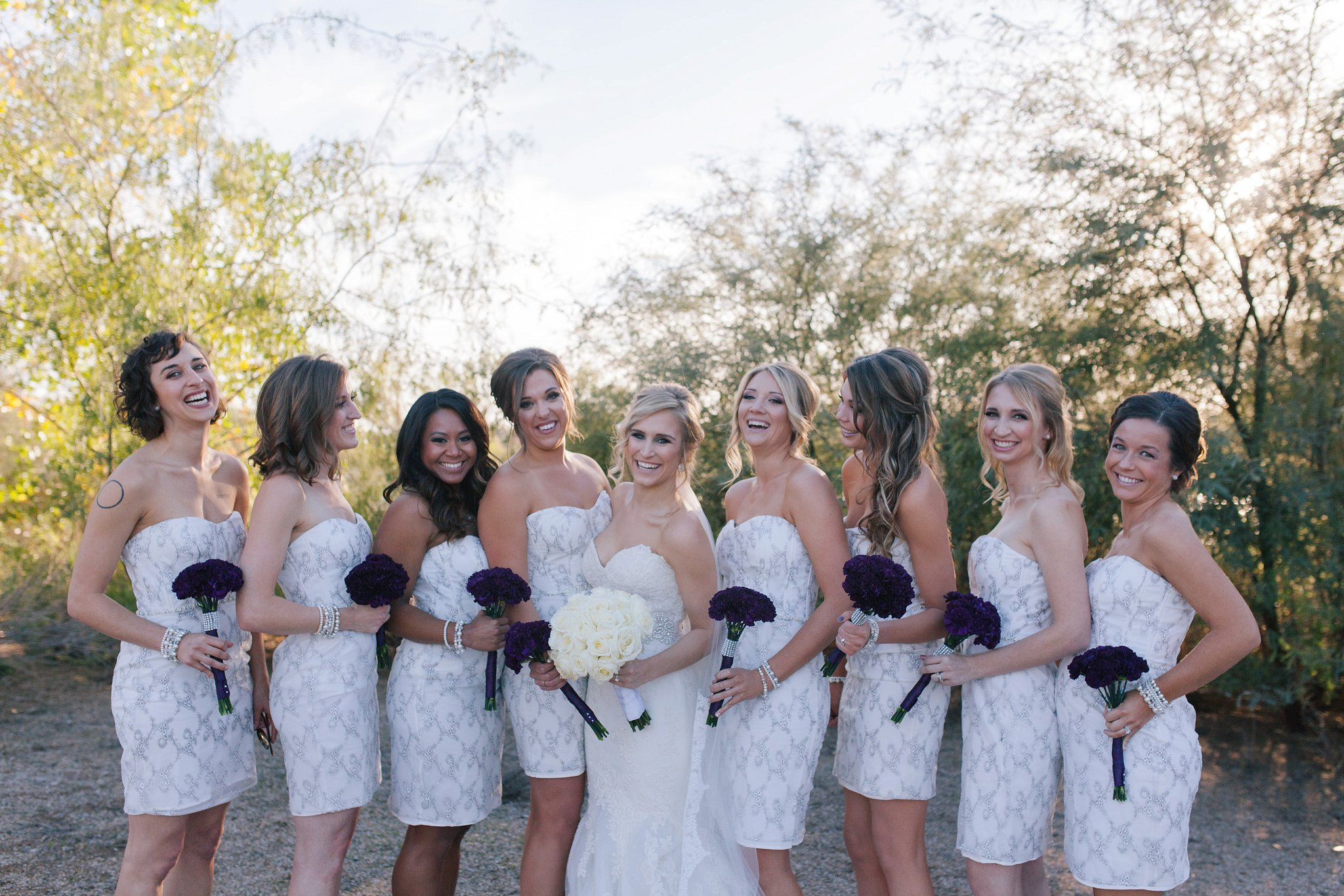 laughing bridal party in all white in Gilbert riparian preserve in Mesa