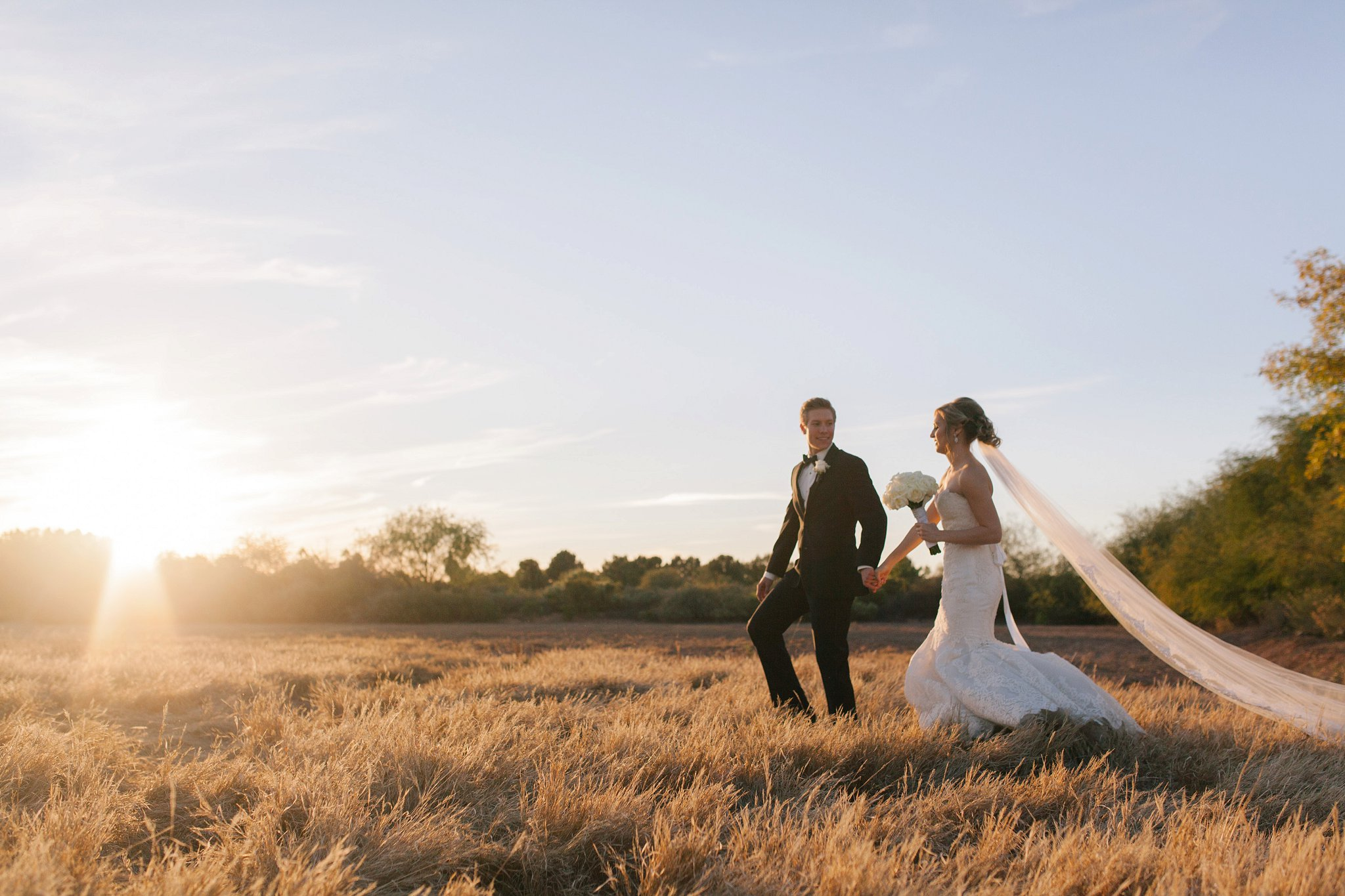bride & groom portraits in a filed Mesa wedding photographer
