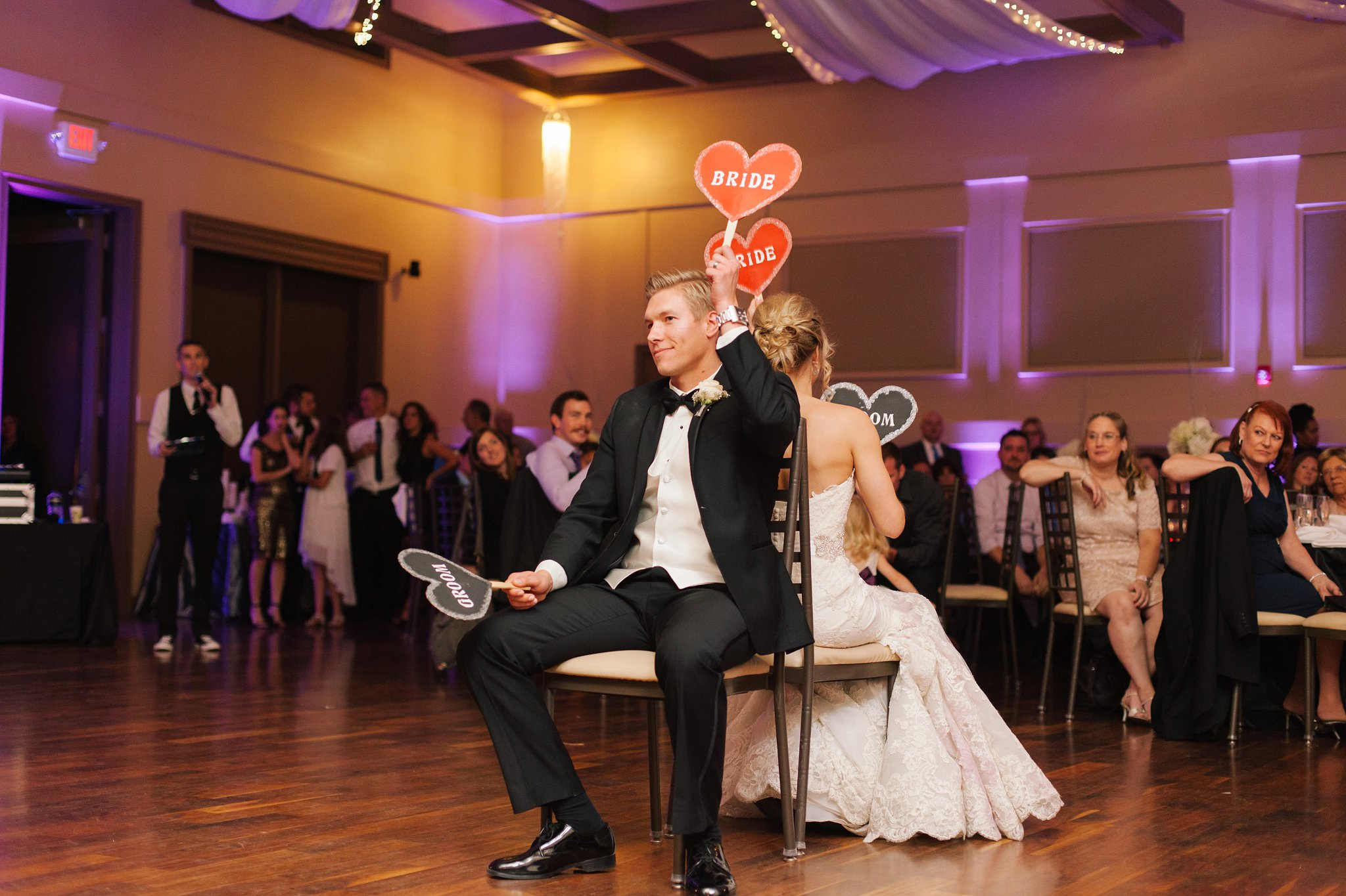 the shoe game at Noah's Event Center in Chandler wedding photographer