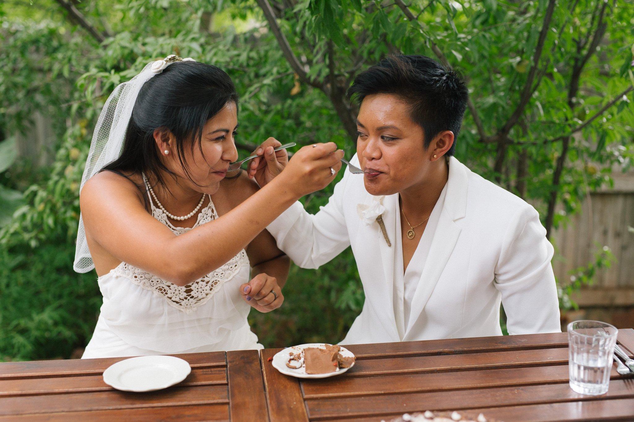 two brides cake cutting at Chocola Tree Sedona elopement