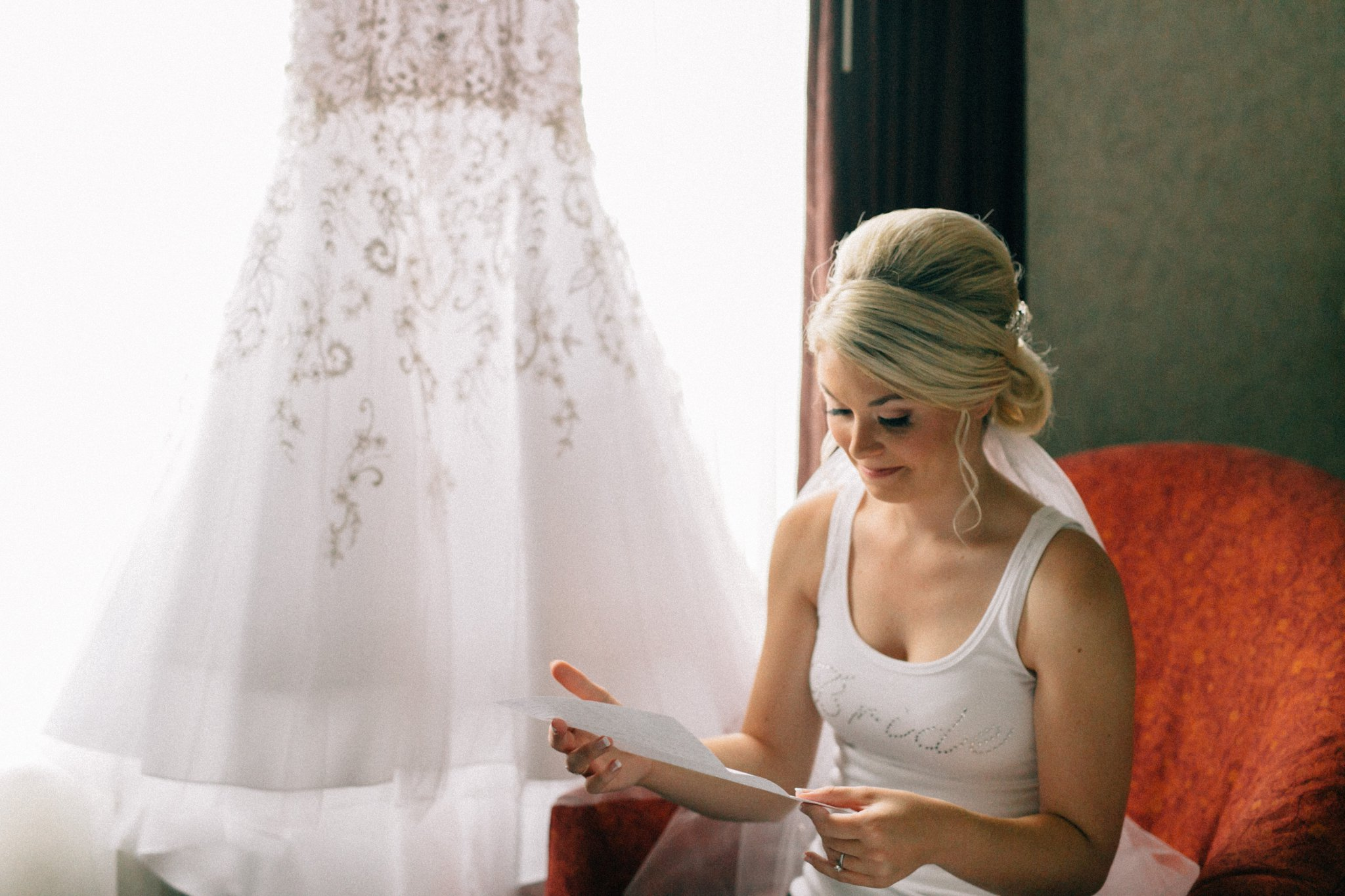 bride reading card from groom at wedding Phoenix wedding photographer