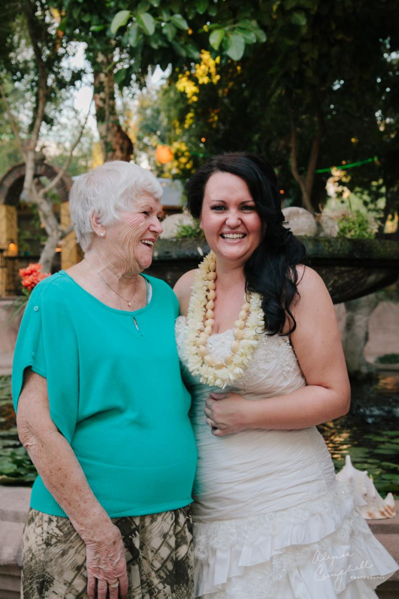 bride and grandmother laughing together at wedding