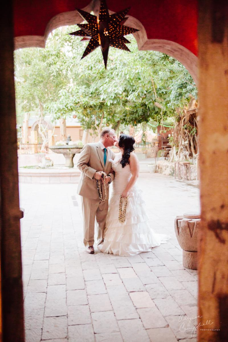 bride and groom kissing before ceremony starts at Boojum Tree