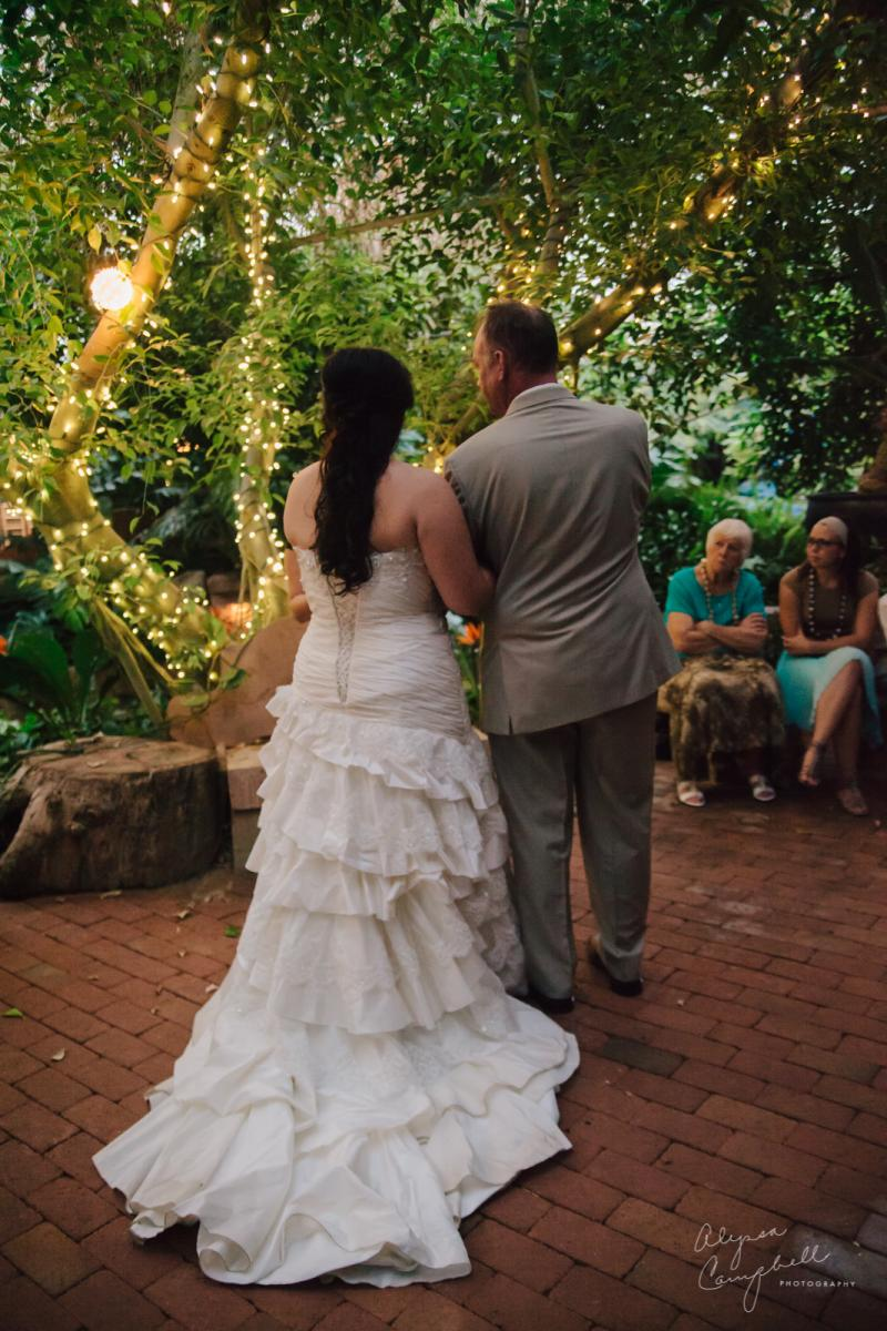 bride and groom facing officiant at Boojum Tree elopement