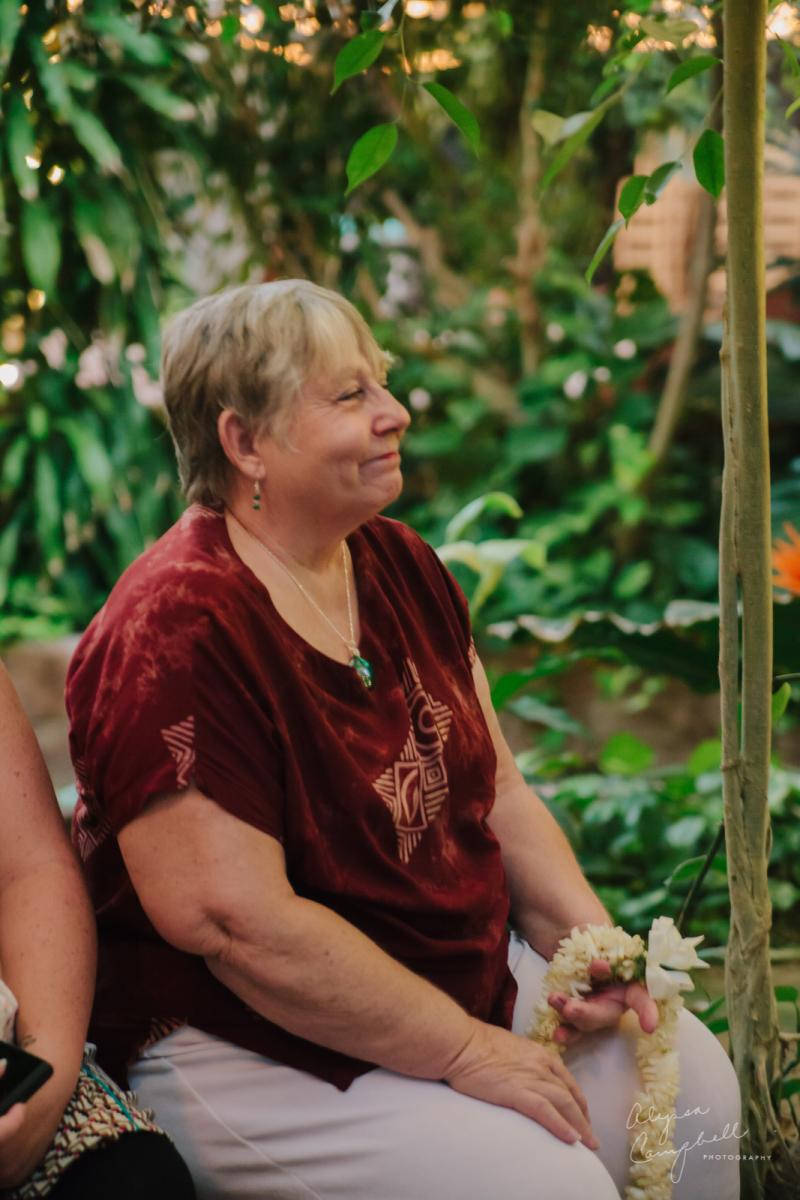 candid moment of mother looking at bride at ceremony