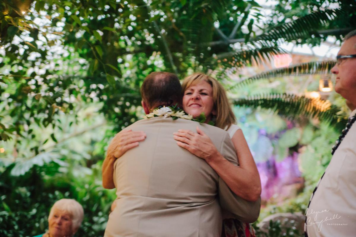 mother in law welcoming new husband into family with hug