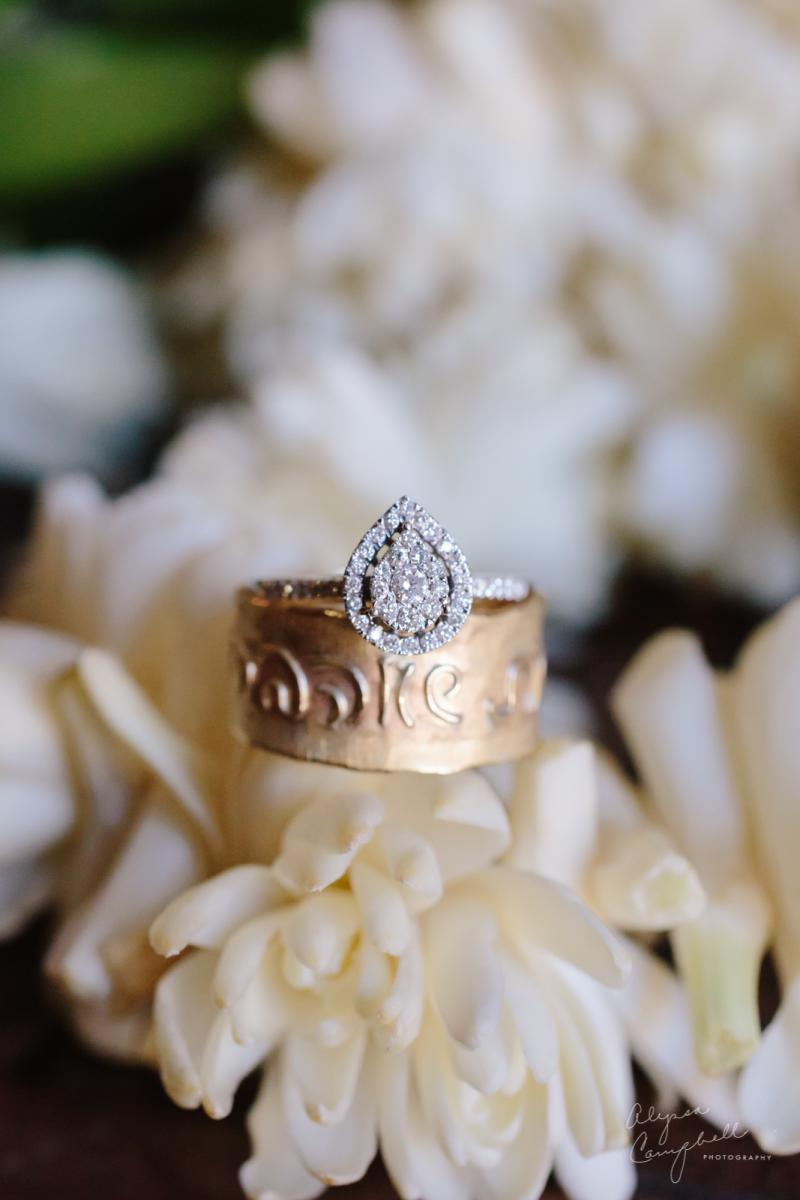 pear shaped wedding ring made of many diamonds and halo of diamonds