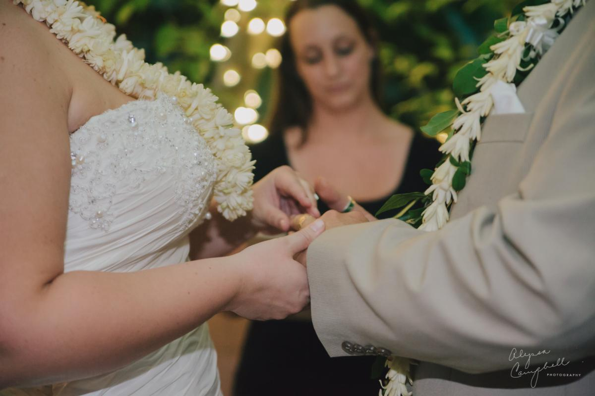 exchanging rings at Boojum Tree elopement Hawaiian ceremony
