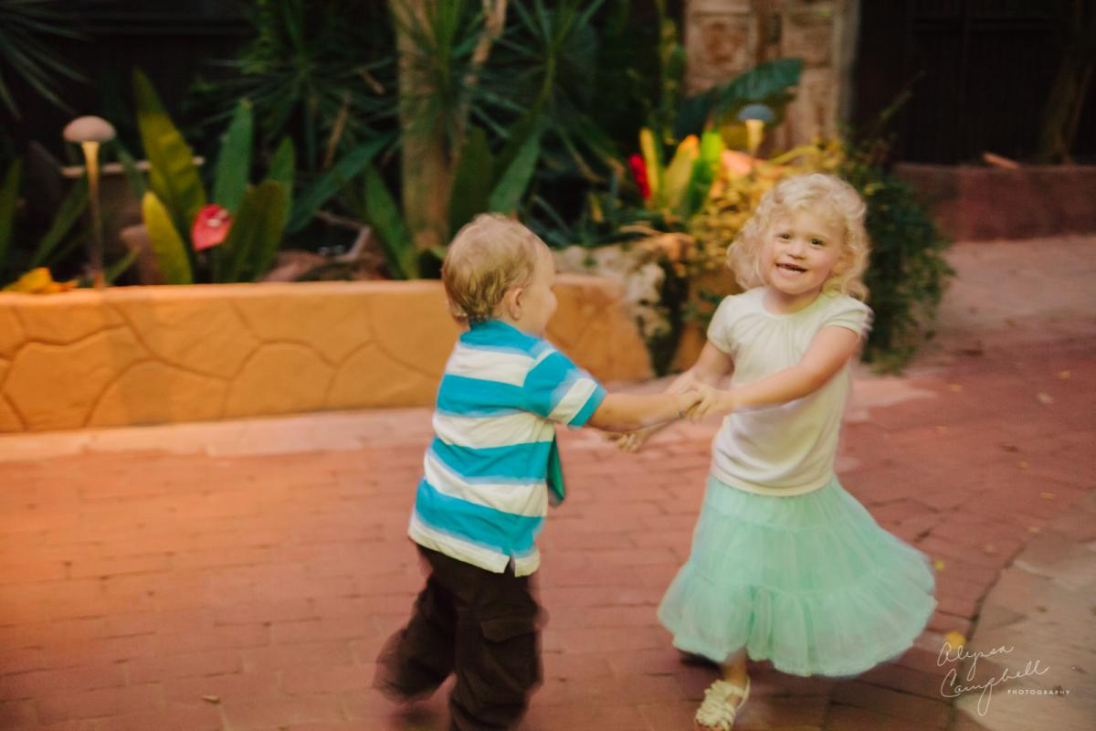 young siblings dancing after wedding ceremony