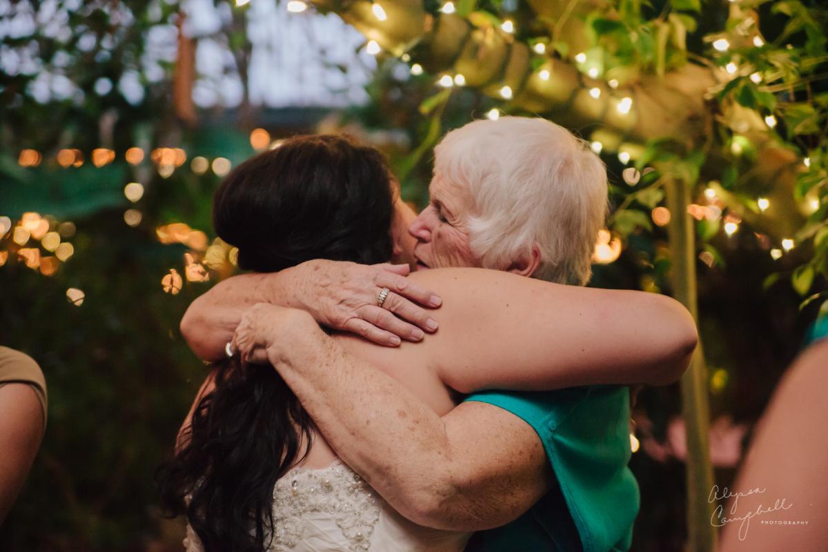 grandma hugging granddaughter after ceremony