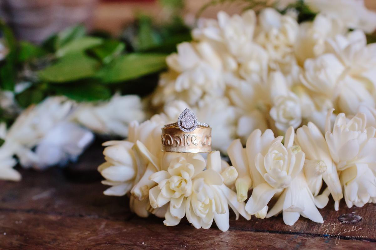 pear shaped diamond wedding ring on Hawaiian wedding lei