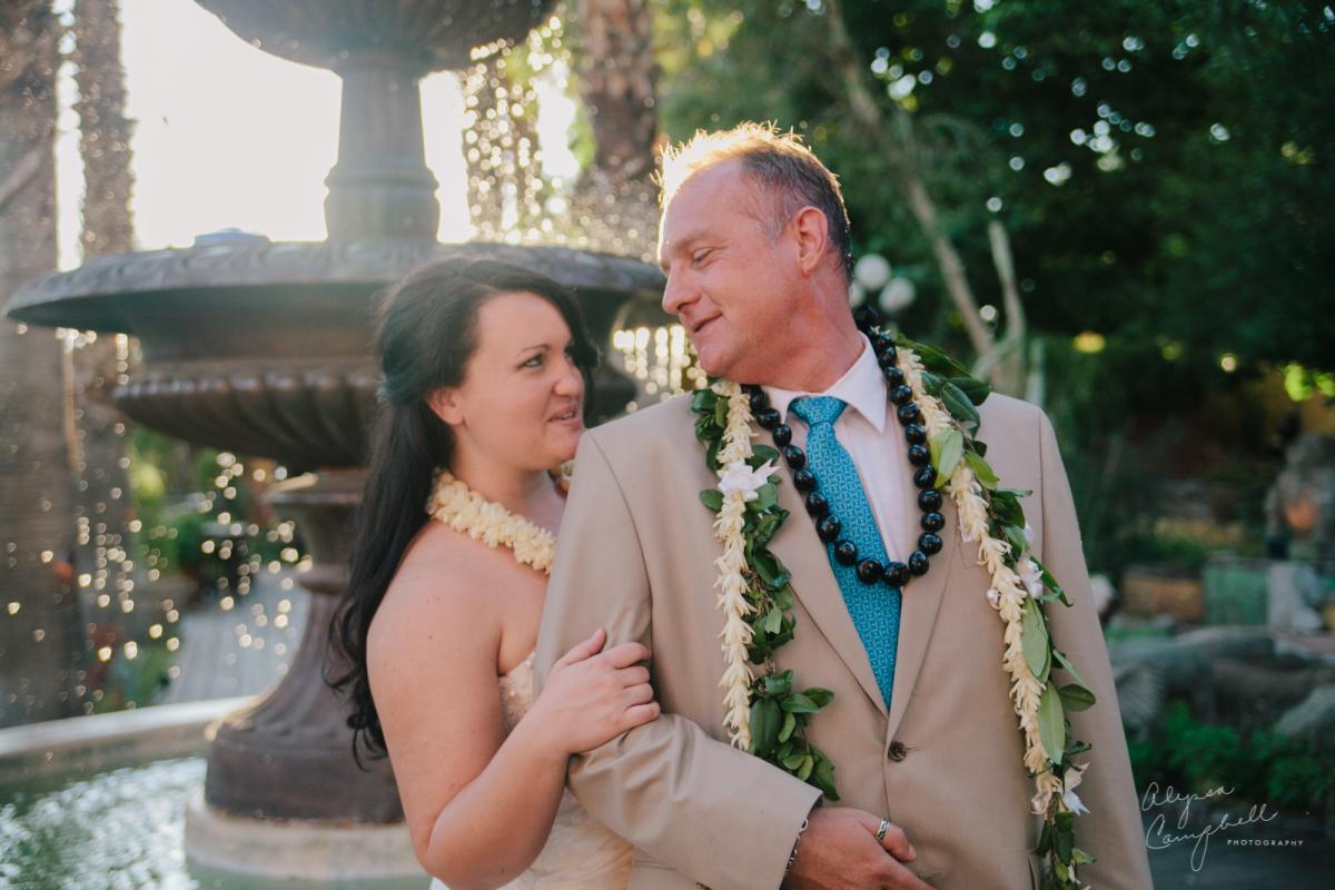 bride looking flirty at groom at Boojum Tree Hidden Gardens Phoenix