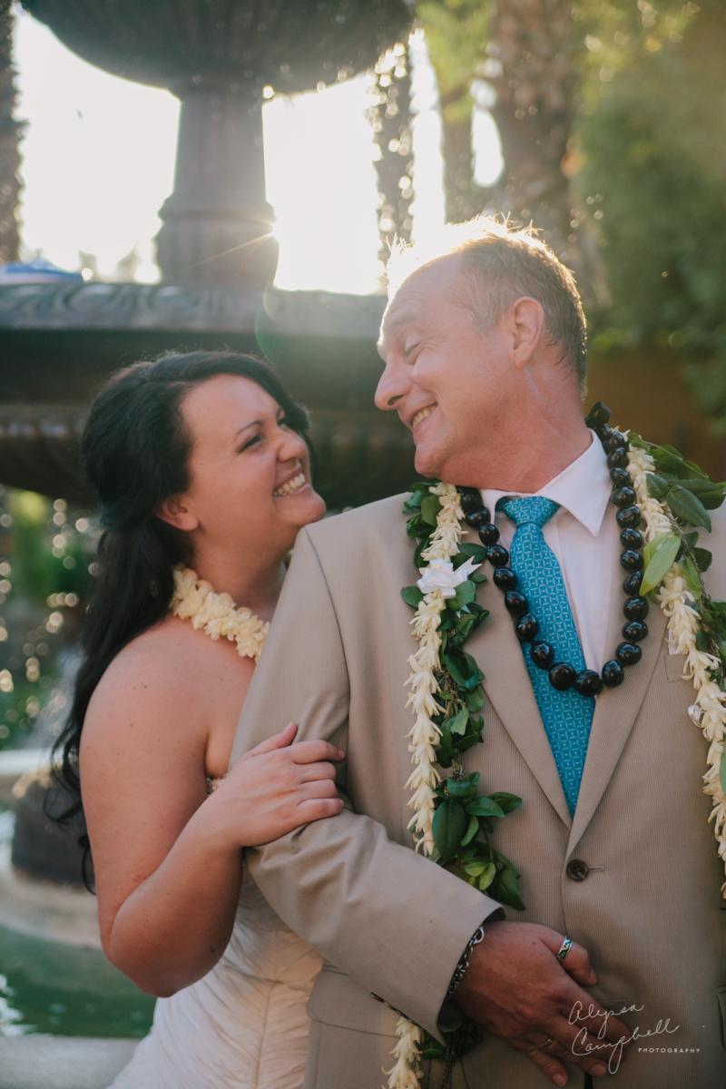 bride and groom laughing at elopement at Boojum Tree Hidden Gardens Phoenix wedding venue