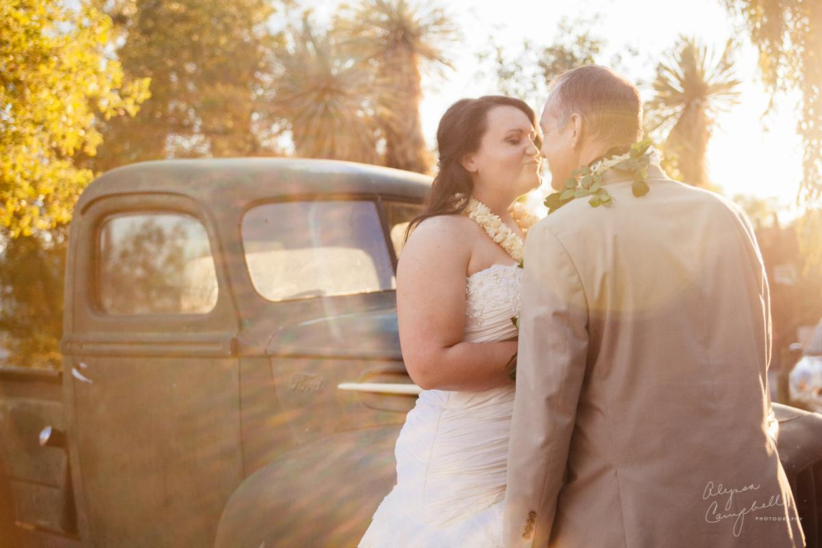 ethereal unset portrait of bride and groom in front of old truck at Boojum Tree wedding venue