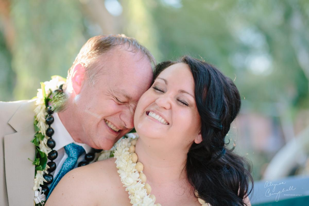 intimate Hawaiian elopement bride and groom laughing together