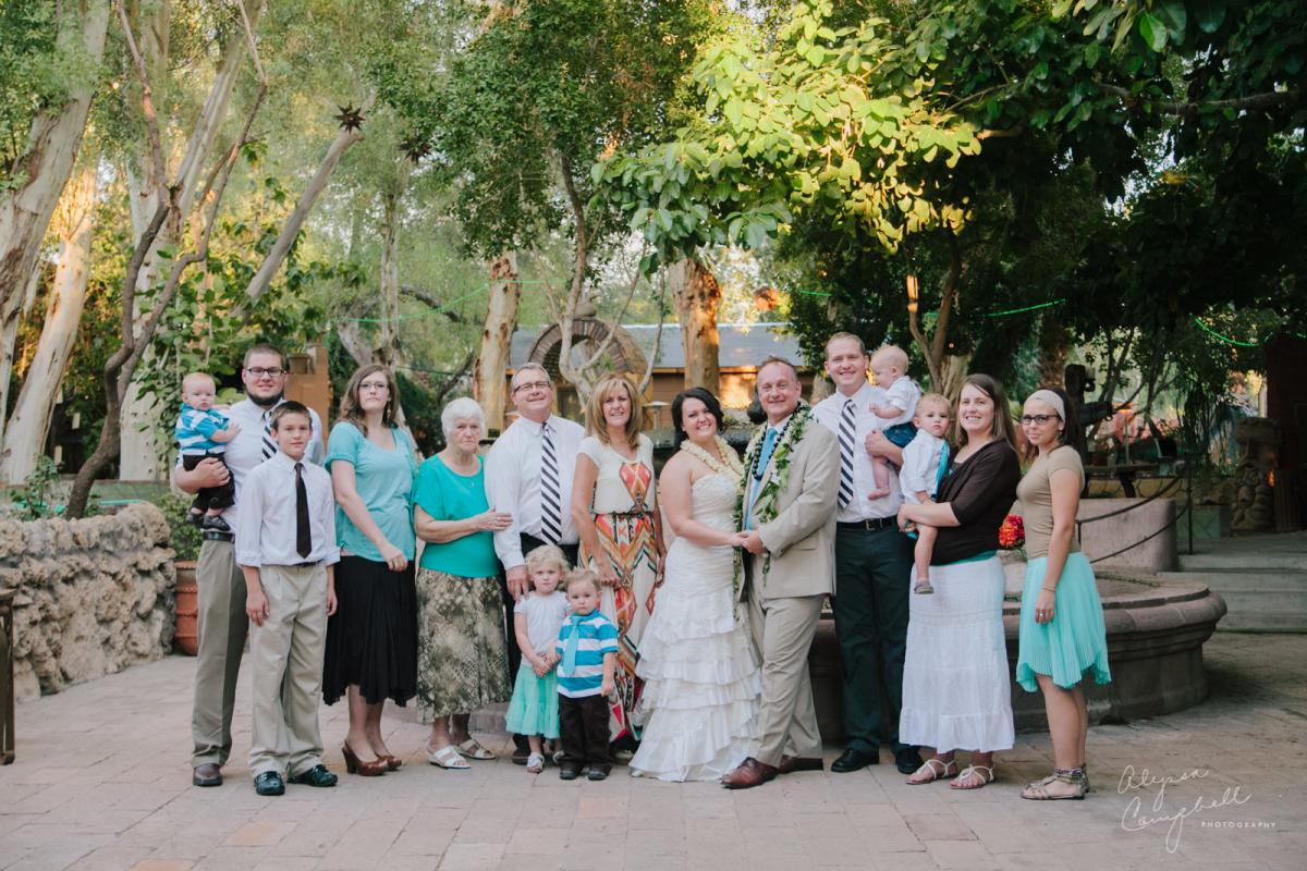 family formal portrait at Boojum Tree Hidden Gardens Phoenix wedding venue