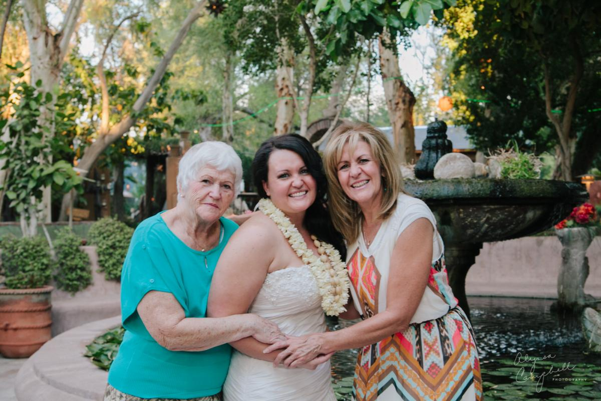 three generations portrait of daughter mother and grandmother at wedding