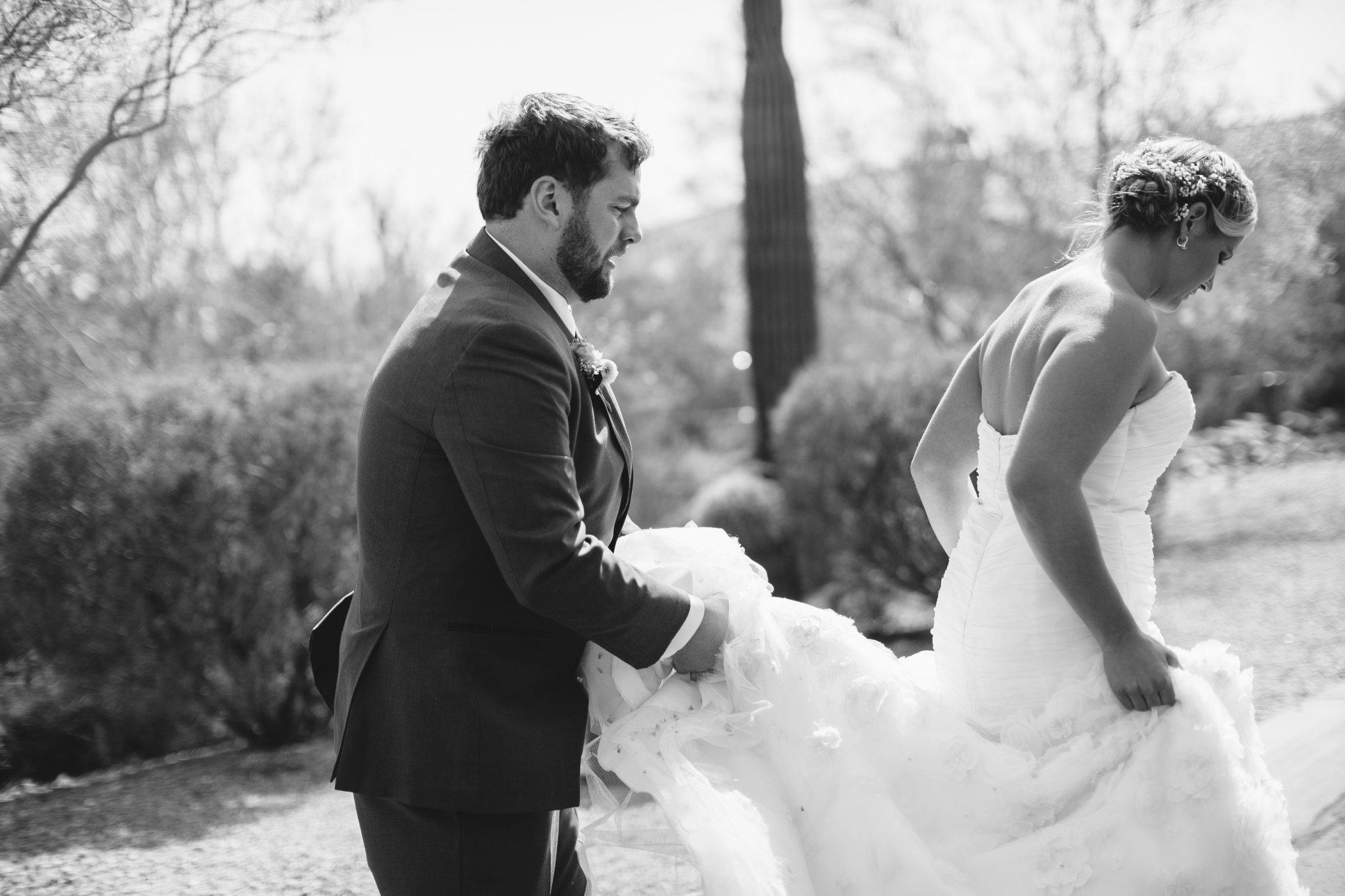 bride & groom walking at Arizona backyard wedding