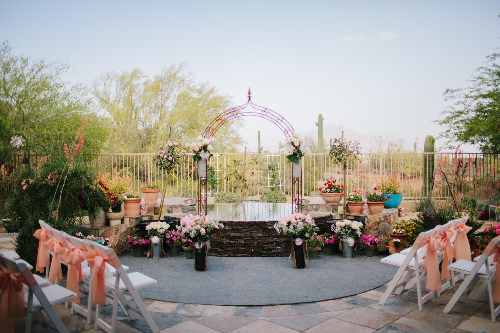 Mesa backyard wedding diy altar on top of backyard pool looking towards Superstition Mountains