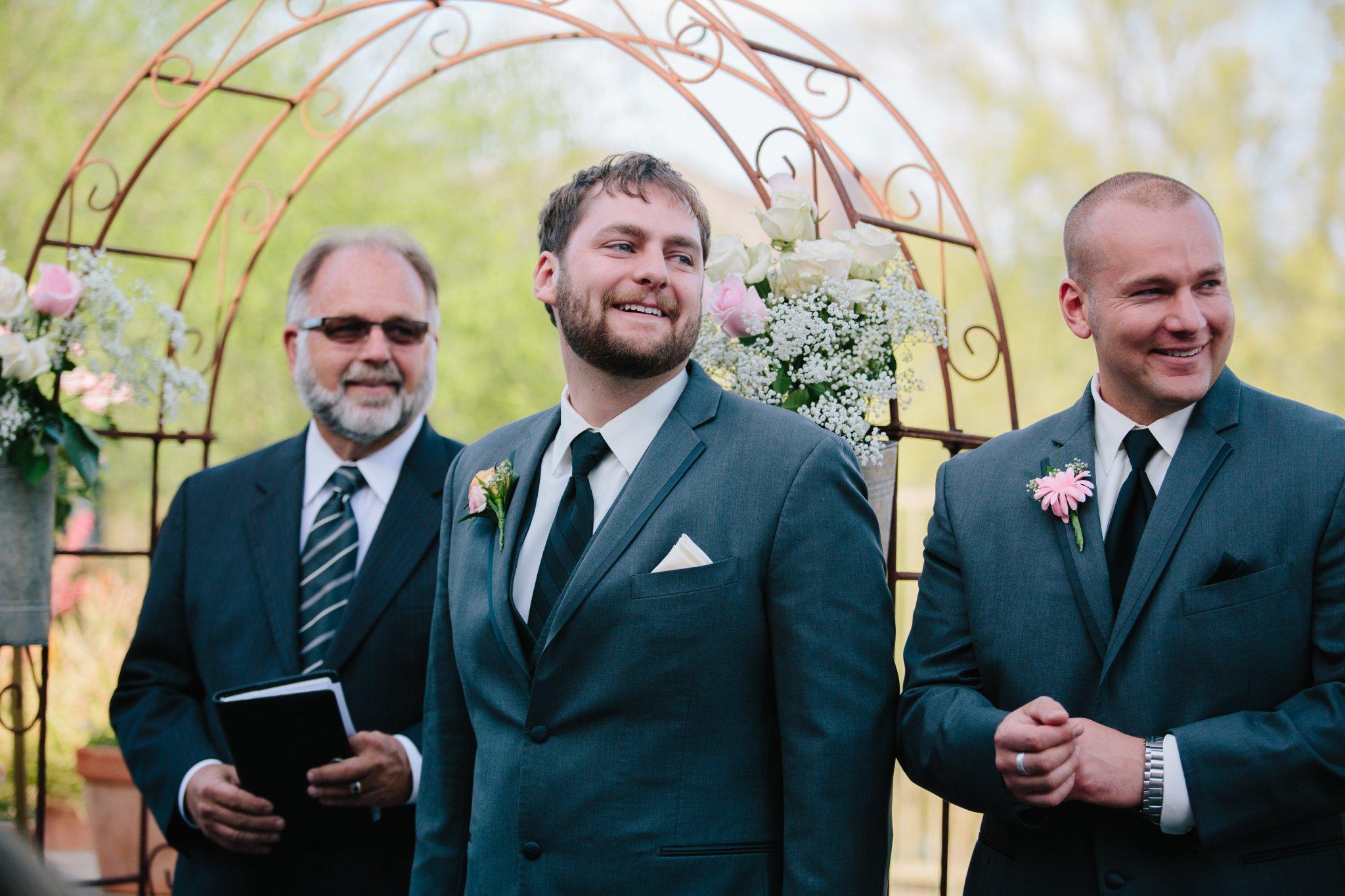 Arizona backyard wedding bride groom seeing bride walk down aisle