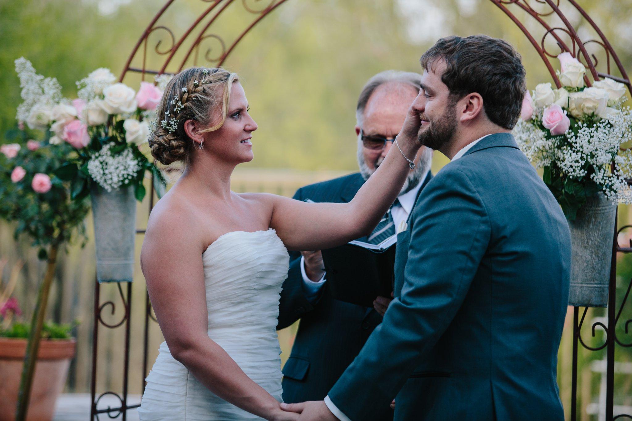 groom's emotional vows & first kiss backyard Arizona wedding