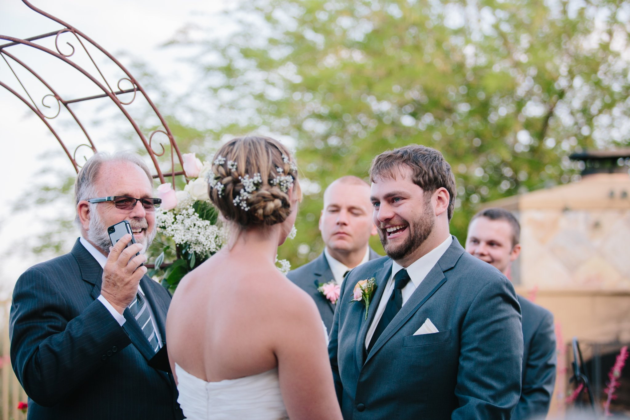 groom laughing at wedding ceremony in backyard in Mesa AZ