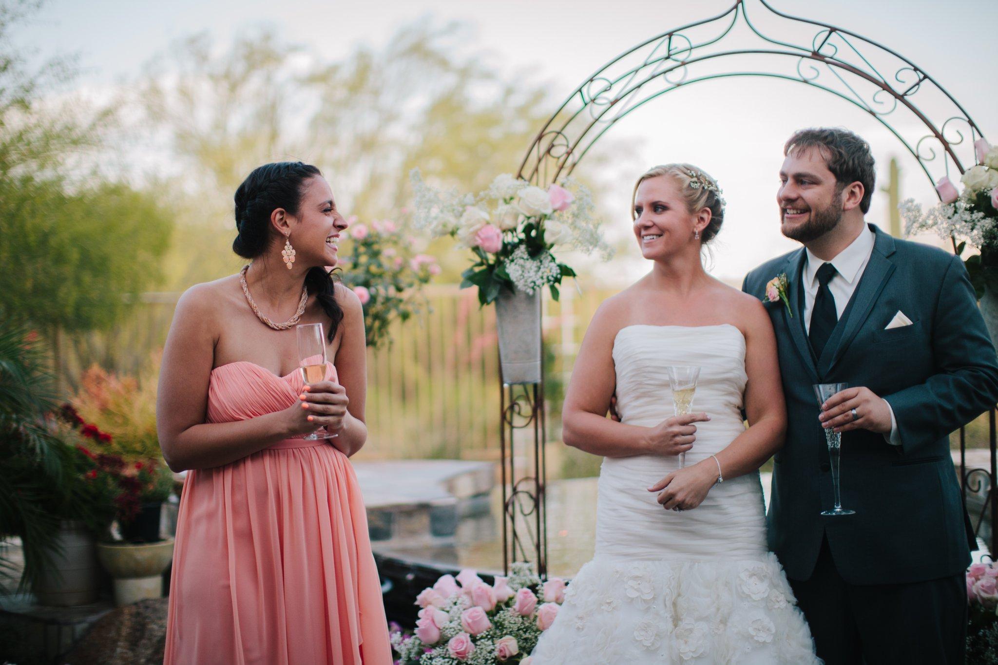 maid of honor making toasts laughing Mesa backyard wedding