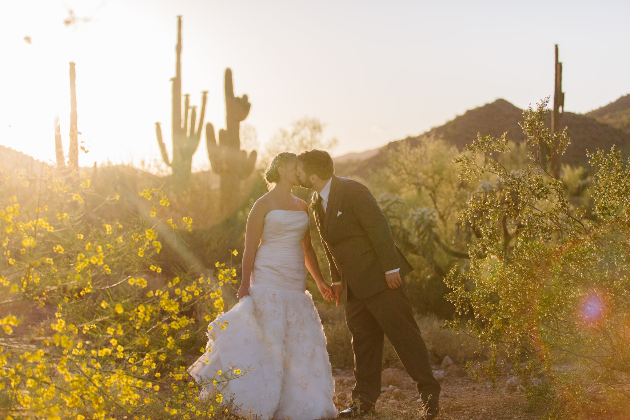 sunlight sunset portrait of bride & groom in AZ desert