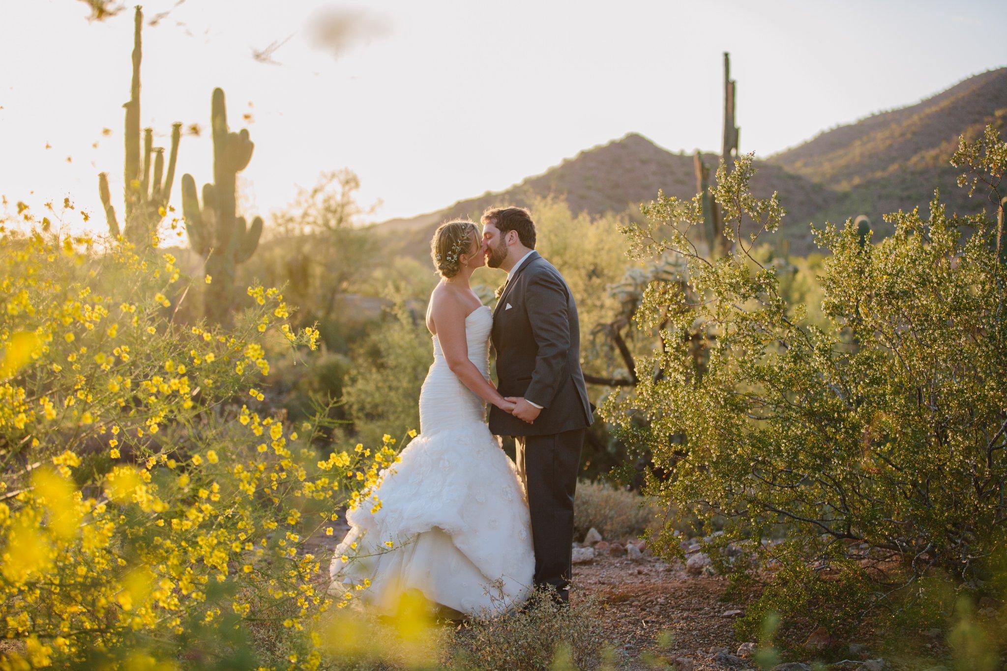 bride & groom in AZ sunset kissing Arizona backyard wedding photographer