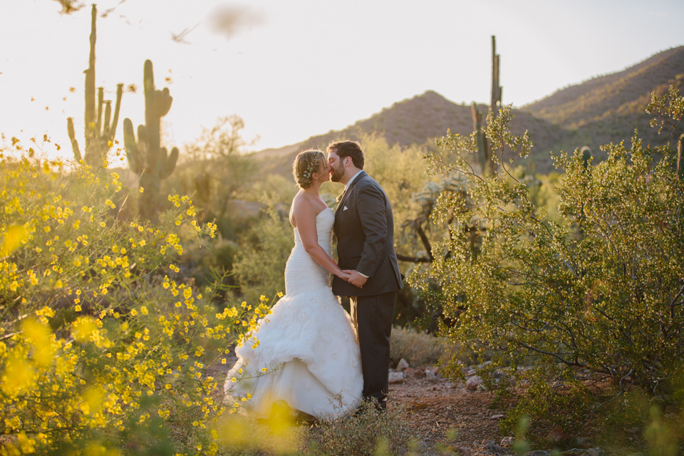 bride and groom almost kissing in Arizona desert