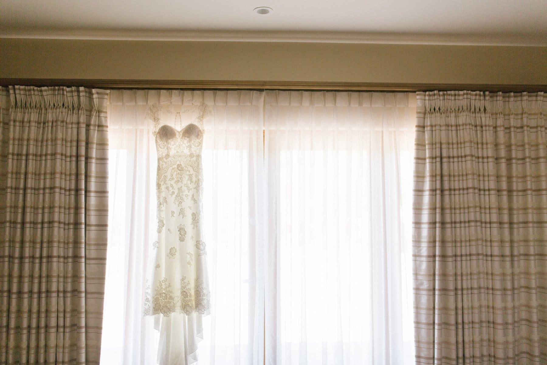 Watters lace dress hanging in window