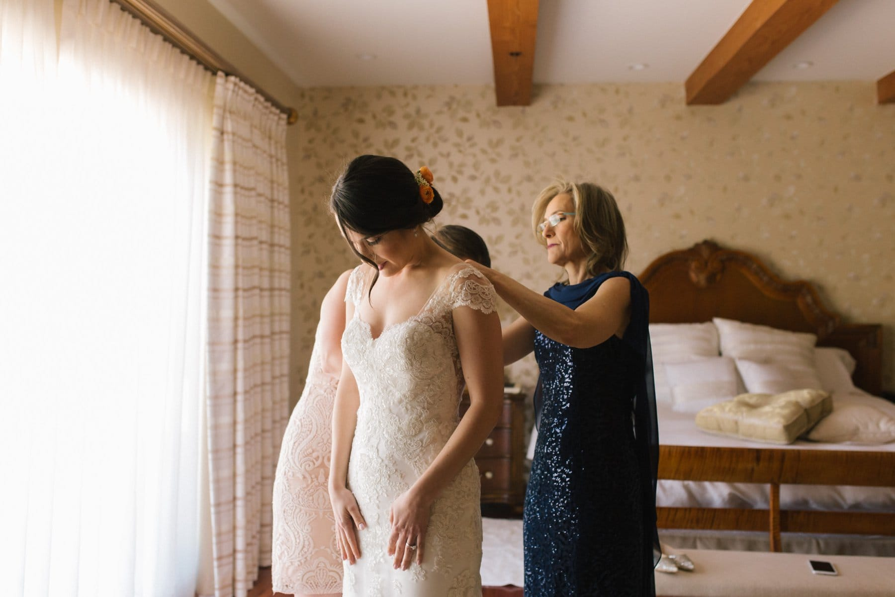 bride getting ready in a home Arizona wedding photographer
