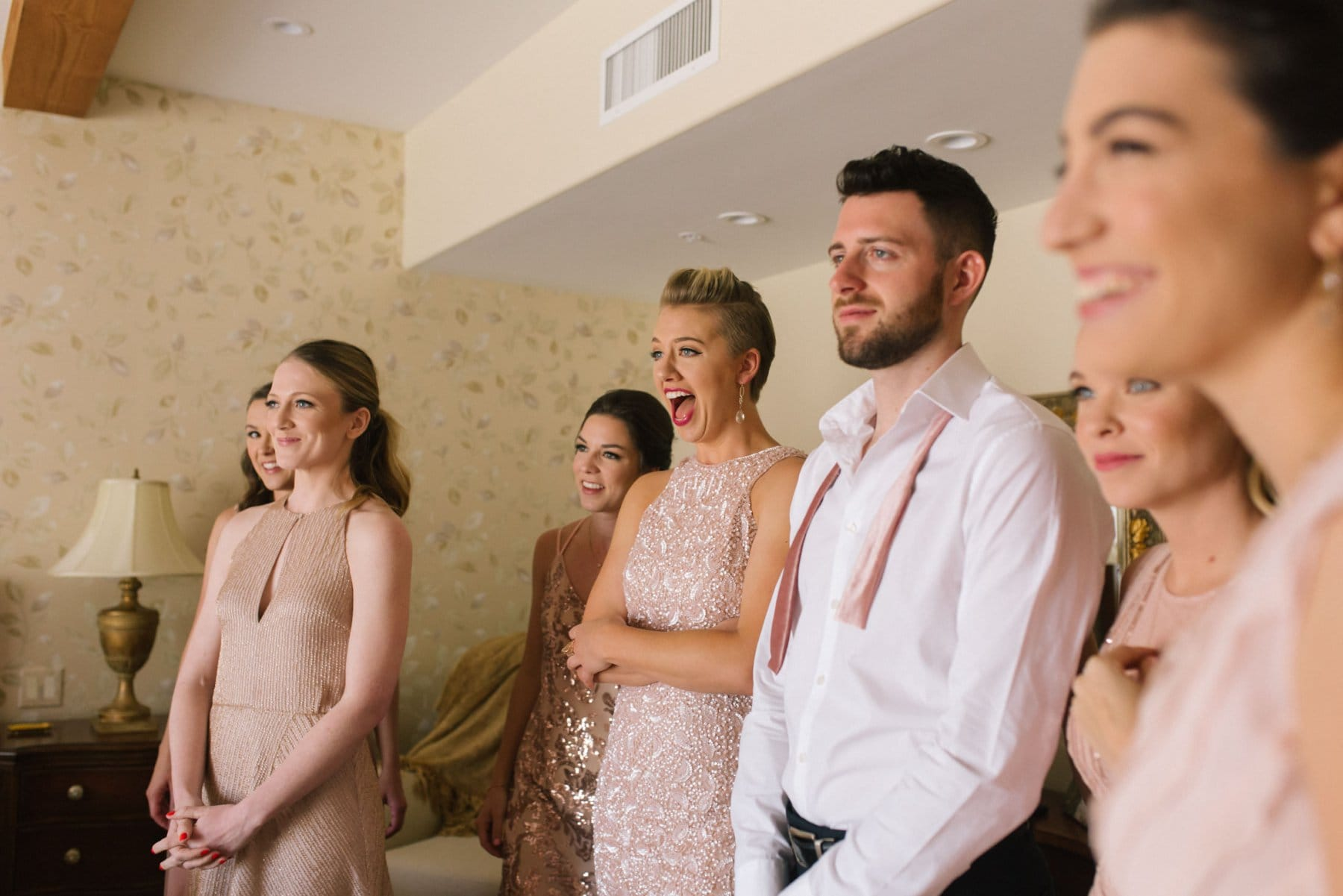 Arizona documentary wedding photographer bridesmaids reacting to bride for first time