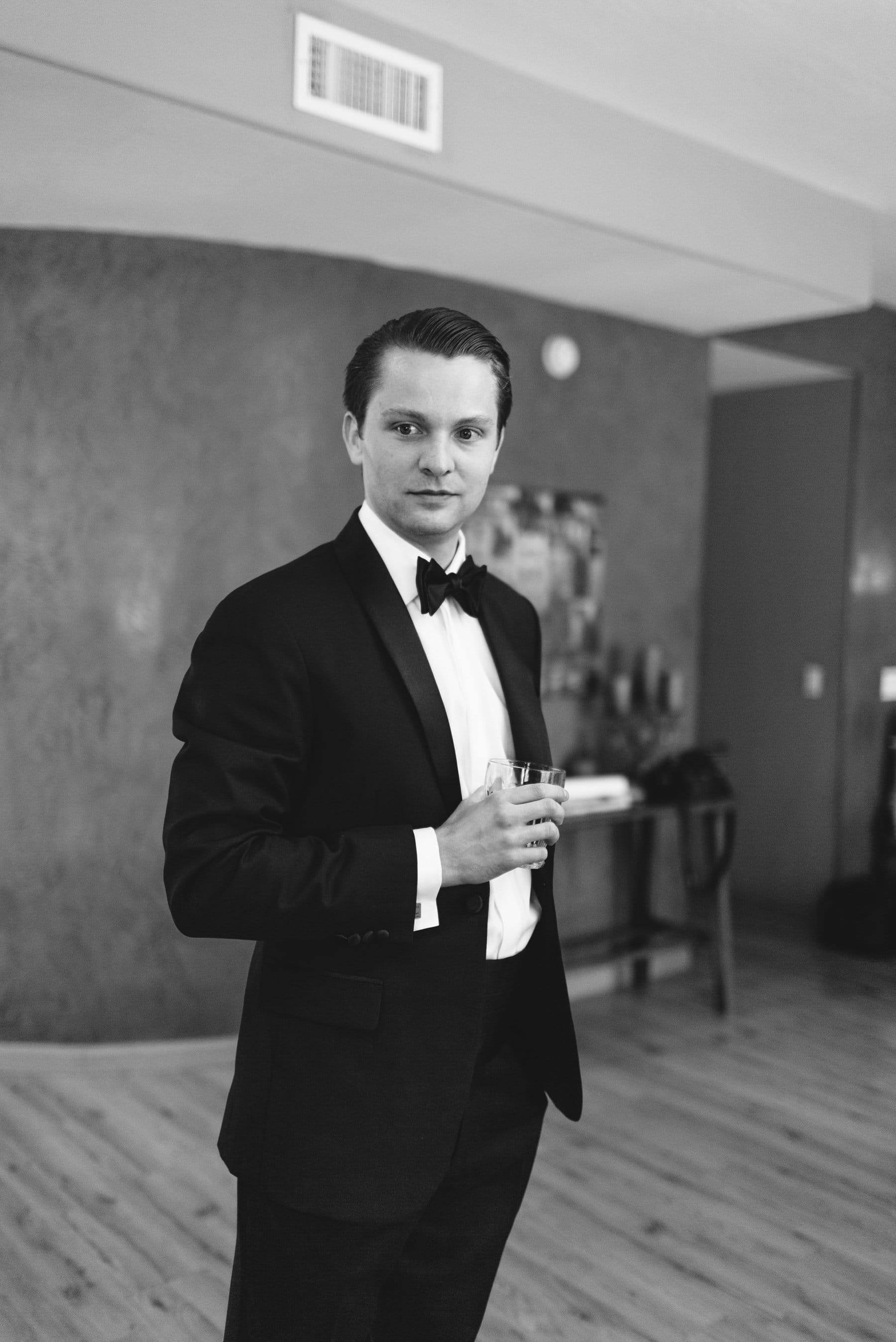 classy groom in tux holding drink Arizona wedding photos