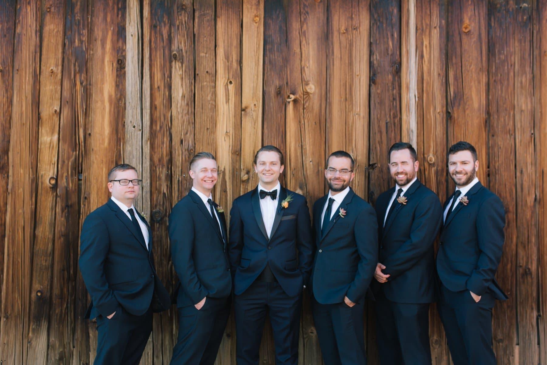 elegant groom and groomsmen at Desert Foothills rustic barn wedding