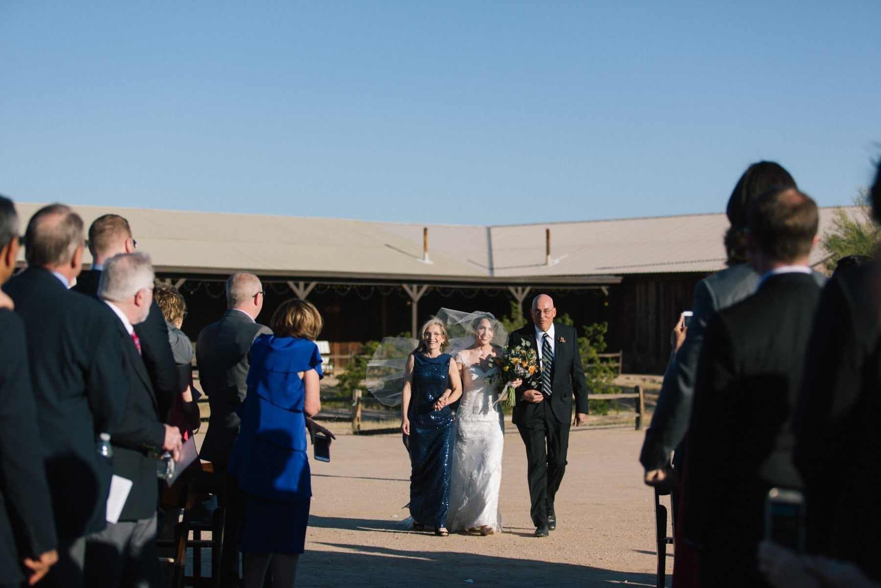 bride walking down aisle at Desert Foothills barn