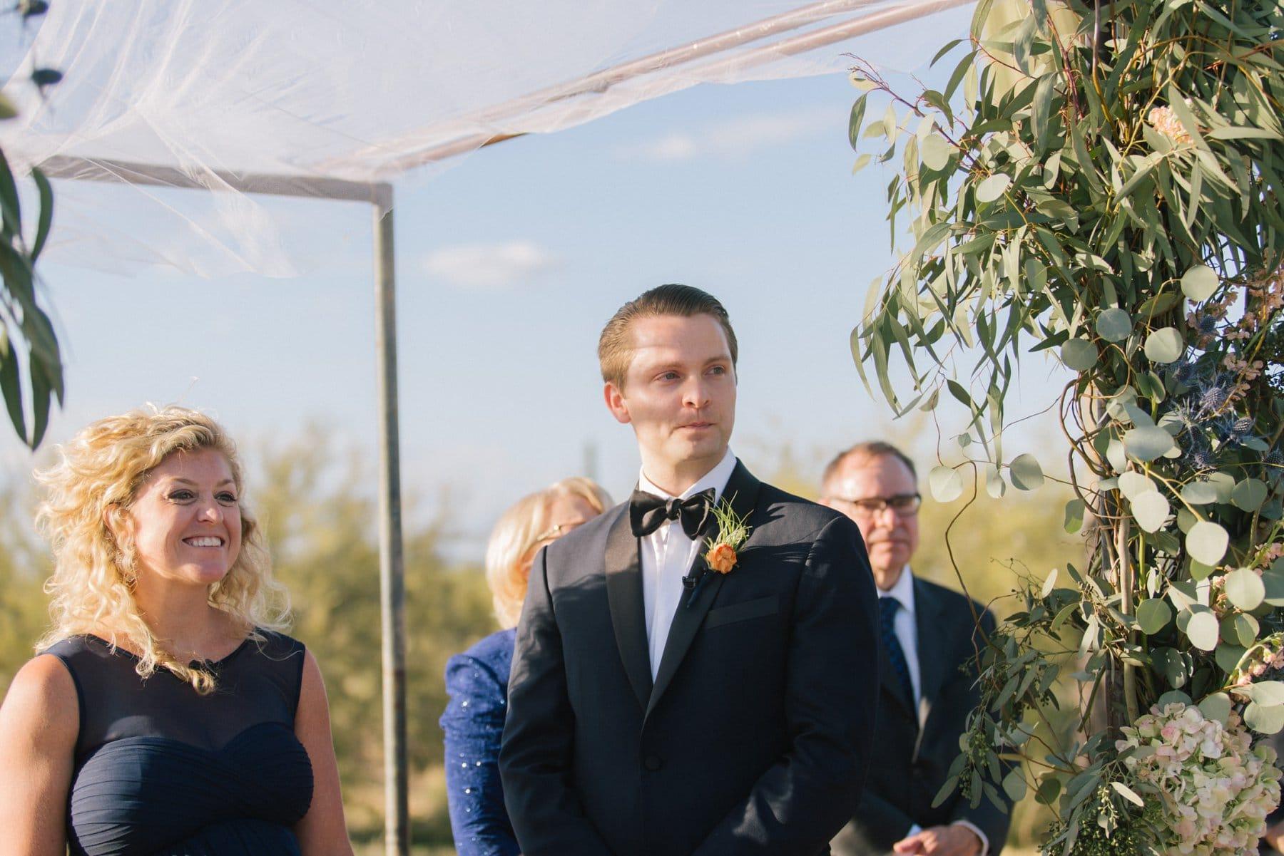 groom seeing bride at Desert Foothills barn wedding Scottsdale