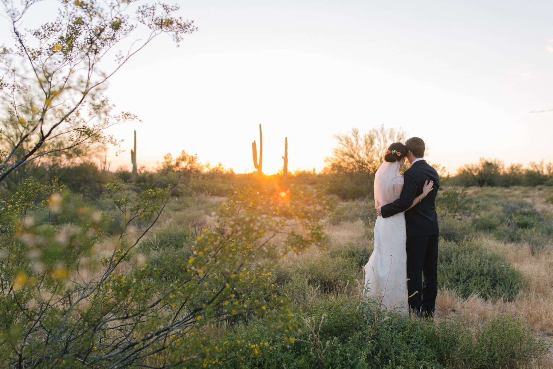 bride & groom photos at sunset Arizona Desert Foothills barn wedding
