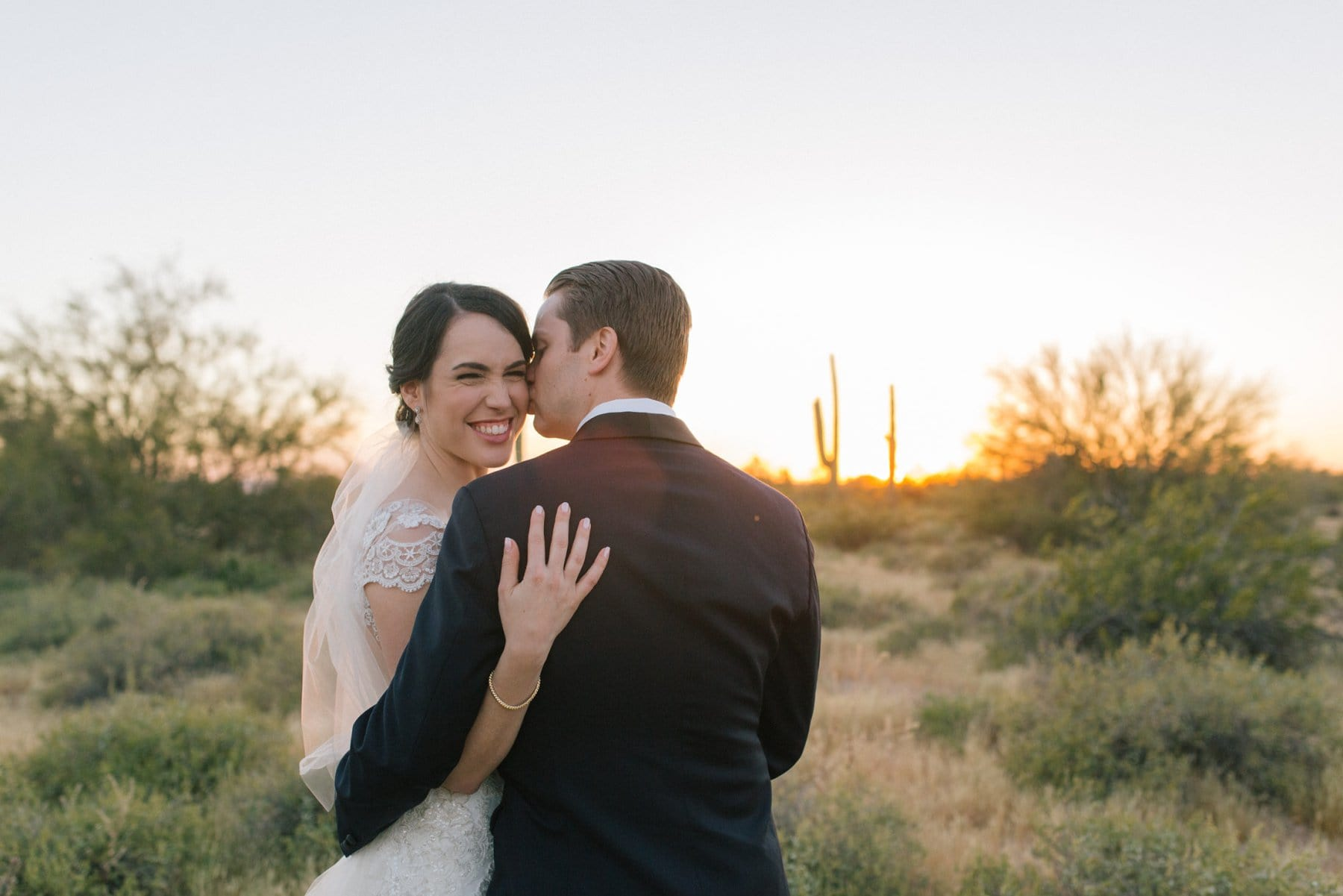 natural laughing bride and groom photos in Arizona desert at Desert Foothills wedding venue