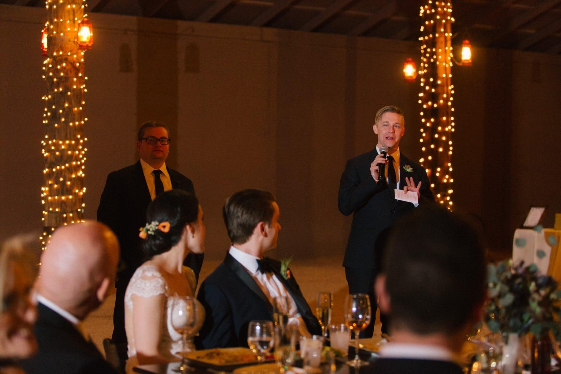 elegant rustic Desert Foothills barn wedding reception toasts