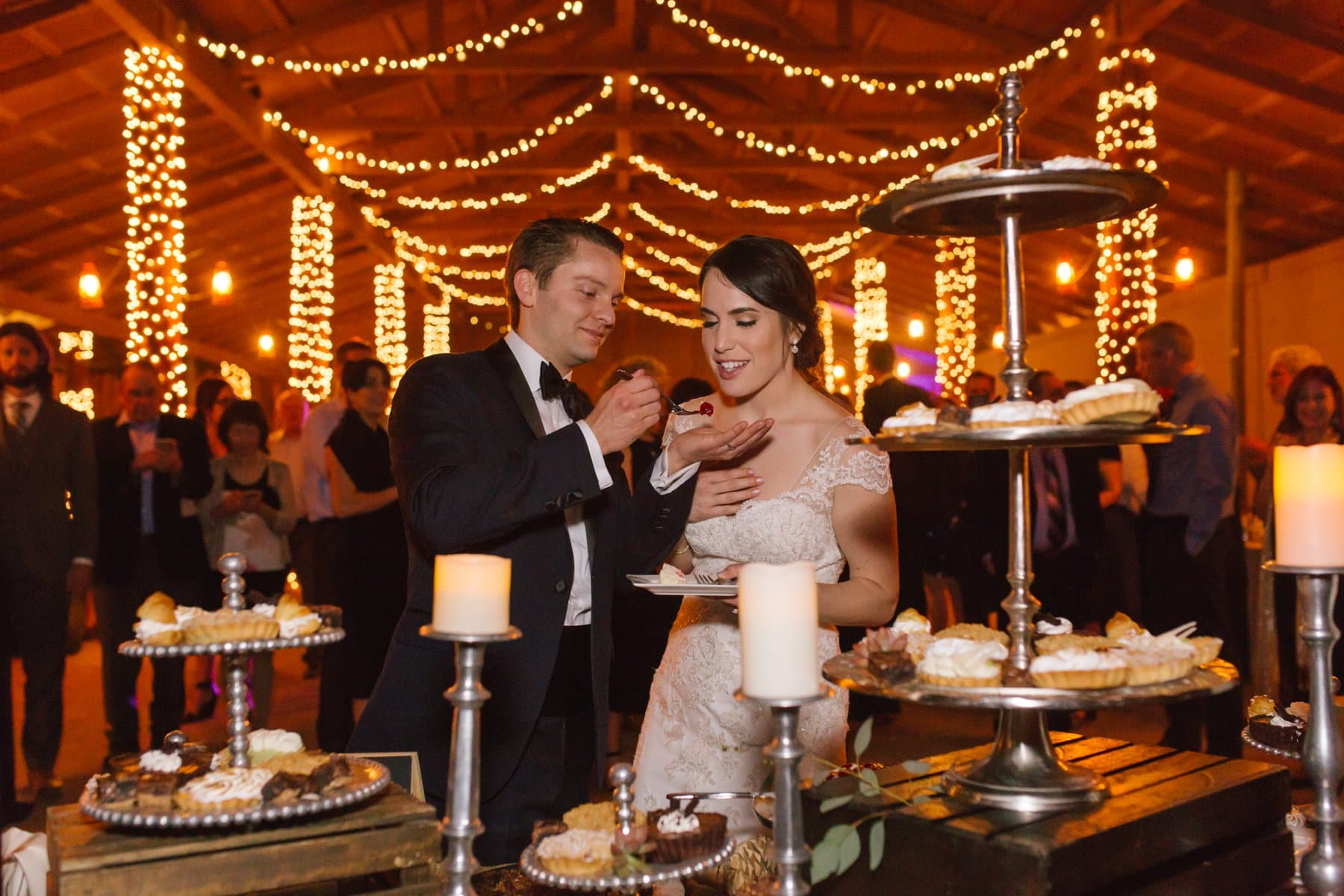 cutting wedding pie at Desert Foothills barn wedding venue