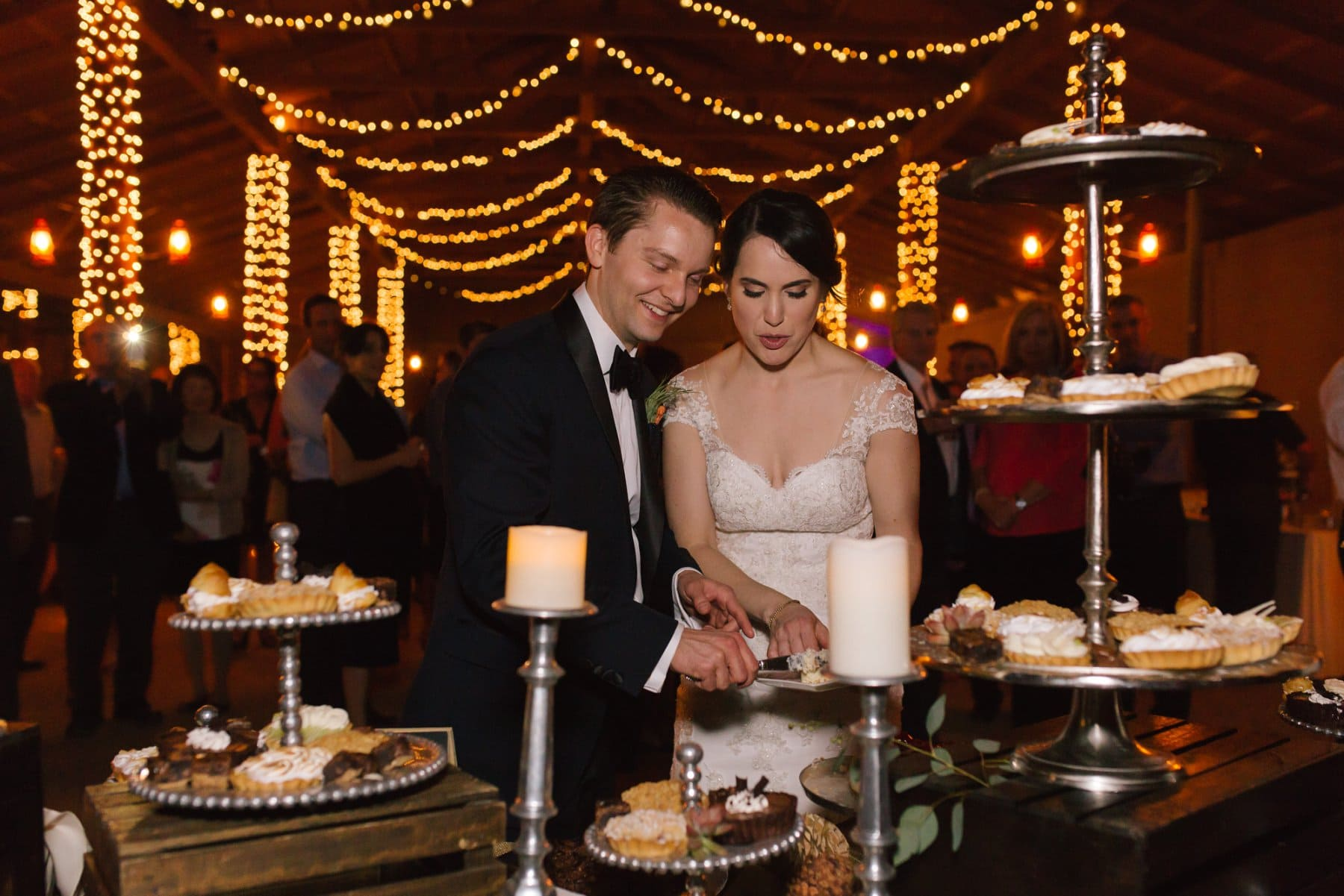 cutting wedding pie at Desert Foothills barn wedding Arizona