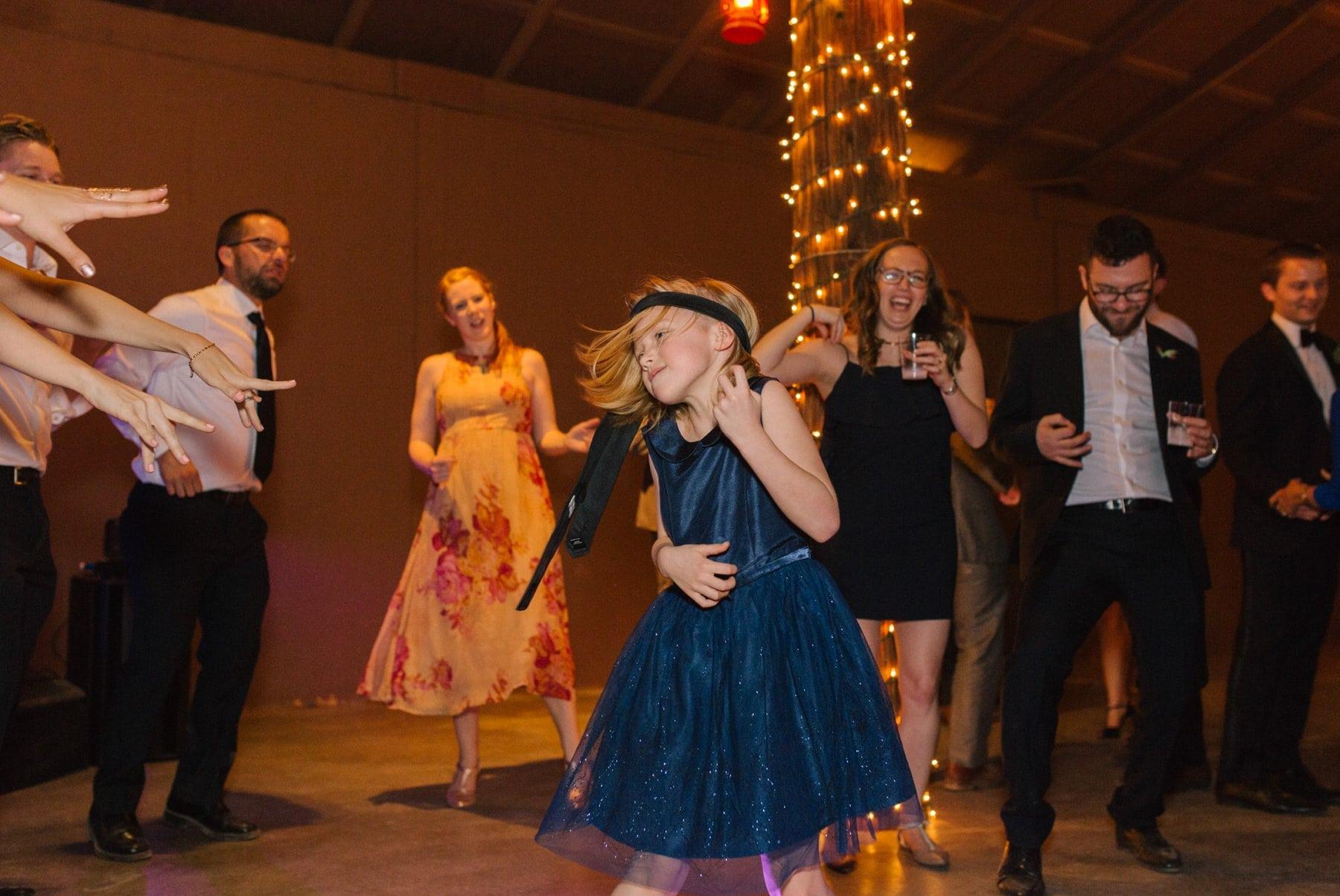 Arizona documentary wedding photographer Alyssa Campbell Desert Foothills wedding reception little girl rocking out