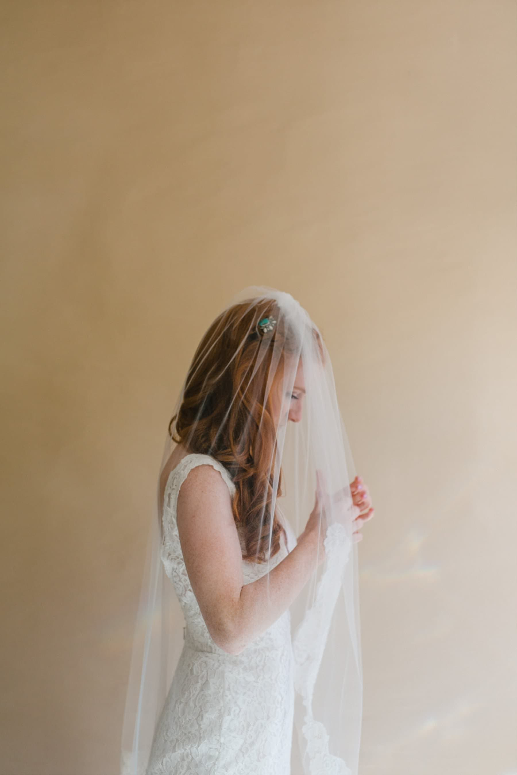 redhead bride with veil Arizona wedding photographer Alyssa Campbell Photography