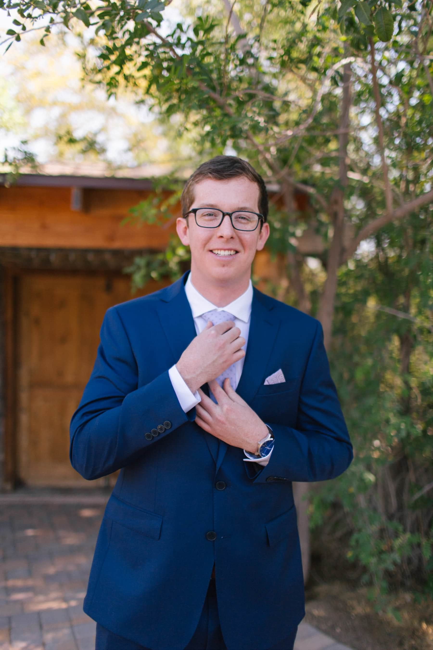 groom in blue suit at Phoenix Zoo wedding
