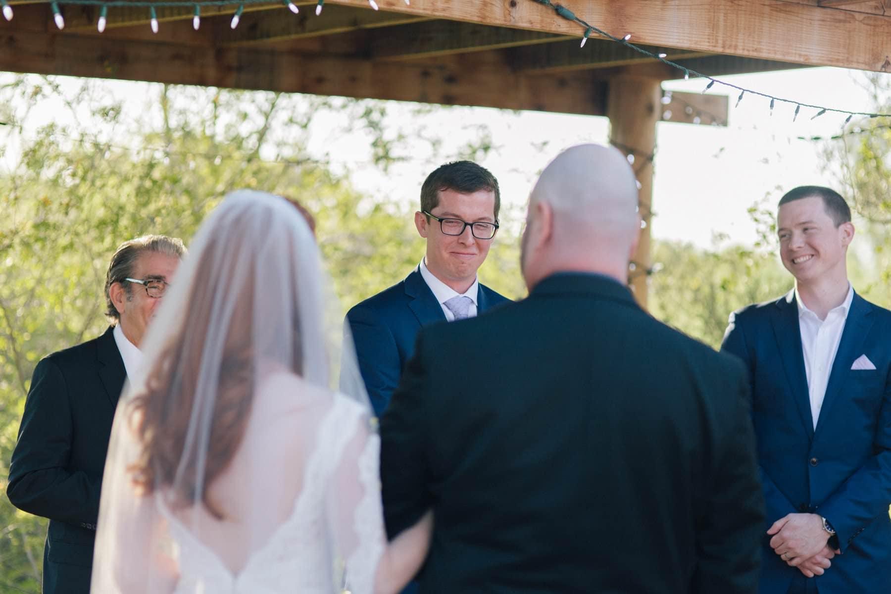 groom seeing bride walk down aisle Phoenix Zoo wedding photos