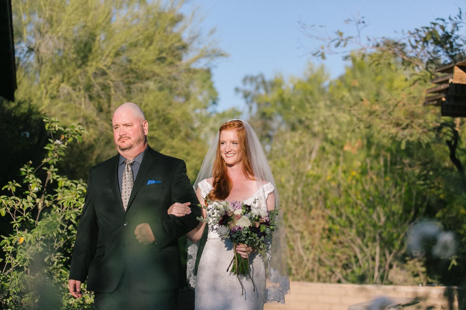 bride walking down aisle Phoenix Zoo wedding